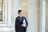 Judge looking out window in courthouse Stock Photo - Premium Royalty-Freenull, Code: 6113-07762344