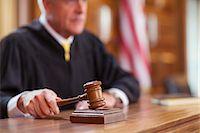 Judge banging gavel in court Stock Photo - Premium Royalty-Freenull, Code: 6113-07762360