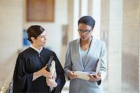 Judge and lawyer talking in courthouse Stock Photo - Premium Royalty-Freenull, Code: 6113-07762384
