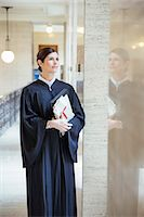 Judge looking out window in courthouse Stock Photo - Premium Royalty-Freenull, Code: 6113-07762392