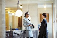 Judge and lawyer talking in courthouse Stock Photo - Premium Royalty-Freenull, Code: 6113-07762398