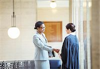 Judge and lawyer shaking hands in courthouse Stock Photo - Premium Royalty-Freenull, Code: 6113-07762417