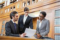 Lawyers examining documents in court Stock Photo - Premium Royalty-Freenull, Code: 6113-07762418