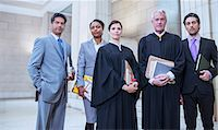 Judges and lawyers standing together in courthouse Stock Photo - Premium Royalty-Freenull, Code: 6113-07762423