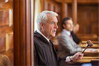 Judge banging gavel in court Stock Photo - Premium Royalty-Freenull, Code: 6113-07762427