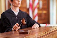 Judge banging gavel in court Stock Photo - Premium Royalty-Freenull, Code: 6113-07762453