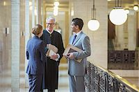 Judge and lawyers talking in courthouse Stock Photo - Premium Royalty-Freenull, Code: 6113-07762455