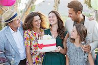Family celebrating birthday together Stock Photo - Premium Royalty-Freenull, Code: 6113-07762472