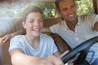Father teaching son to drive Stock Photo - Premium Royalty-Freenull, Code: 6113-07762479
