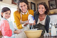 Three generations of women baking together Stock Photo - Premium Royalty-Freenull, Code: 6113-07762481