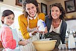 Three generations of women baking together