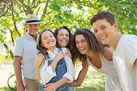 Smiling family playing together Stock Photo - Premium Royalty-Freenull, Code: 6113-07762485