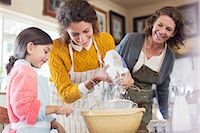 Three generations of woman baking together Stock Photo - Premium Royalty-Freenull, Code: 6113-07762515