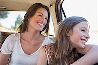 Sisters riding in car backseat together Stock Photo - Premium Royalty-Freenull, Code: 6113-07762537