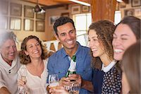 Family celebrating with drinks Stock Photo - Premium Royalty-Freenull, Code: 6113-07762544