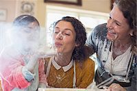 Three generations of women playing with flour Stock Photo - Premium Royalty-Freenull, Code: 6113-07762547