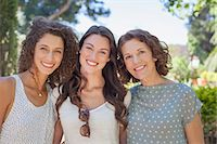 Mother and daughters hugging outdoors Stock Photo - Premium Royalty-Freenull, Code: 6113-07762593