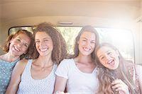 Four women sitting in backseat of car Stock Photo - Premium Royalty-Freenull, Code: 6113-07762619