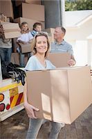 Family carrying boxes from moving van Stock Photo - Premium Royalty-Freenull, Code: 635-07763016