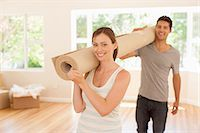 Couple carrying carpet into new house Stock Photo - Premium Royalty-Freenull, Code: 635-07763021