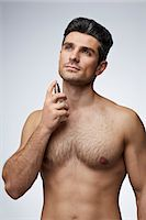 shirtless men - Man spraying perfume on the neck Stock Photo - Premium Royalty-Freenull, Code: 613-07767955