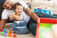 Father playing with young daughter Stock Photo - Premium Royalty-Freenull, Code: 614-07768264