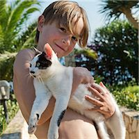 Smiling boy with cat, Sicily, Italy Stock Photo - Premium Royalty-Freenull, Code: 6102-07768759
