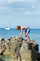Boy at sea, Sicily, Italy Stock Photo - Premium Royalty-Freenull, Code: 6102-07768766