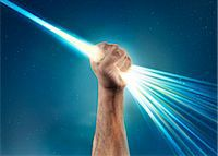 hand holding light laser beam that bursts out Stock Photo - Premium Royalty-Freenull, Code: 613-07780654