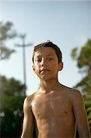 Child near water Stock Photo - Premium Royalty-Freenull, Code: 613-07780725