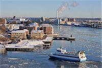 Buildings at harbor Stock Photo - Premium Royalty-Freenull, Code: 6102-07789570