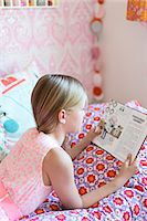 Girl reading in her room Stock Photo - Premium Royalty-Freenull, Code: 6102-07789596