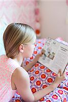 Girl reading in her room Stock Photo - Premium Royalty-Freenull, Code: 6102-07789598