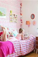 Girl reading in her room Stock Photo - Premium Royalty-Freenull, Code: 6102-07789602