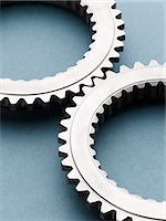 Close up of interlocking metal gears Stock Photo - Premium Royalty-Freenull, Code: 6113-07790183