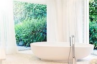 shower - Bathtub, curtains, and windows in modern bathroom Stock Photo - Premium Royalty-Freenull, Code: 6113-07790574