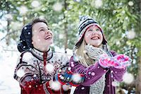 Siblings catching snow together Stock Photo - Premium Royalty-Freenull, Code: 6113-07790600