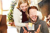 present wrapped close up - Couple exchanging gifts on Christmas Stock Photo - Premium Royalty-Freenull, Code: 6113-07790629