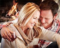 sweater and fireplace - Couple enjoying drinks together Stock Photo - Premium Royalty-Freenull, Code: 6113-07790692