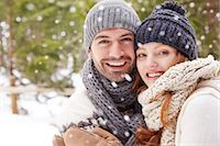 snowflakes  holiday - Couple hugging in snow Stock Photo - Premium Royalty-Freenull, Code: 6113-07790711