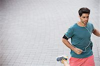 runner (male) - Man running through city streets Stock Photo - Premium Royalty-Freenull, Code: 6113-07790749