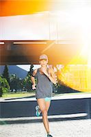 fit people - Woman running through city streets Stock Photo - Premium Royalty-Freenull, Code: 6113-07790761