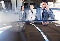 person walking on parking lot - Business people walking towards car in parking garage Stock Photo - Premium Royalty-Freenull, Code: 6113-07790880