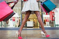 people on mall - Woman carrying shopping bags in shopping mall Stock Photo - Premium Royalty-Freenull, Code: 6113-07790919