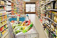 Close up of full shopping cart in grocery store Stock Photo - Premium Royalty-Freenull, Code: 6113-07790927