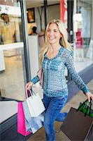 people on mall - Woman carrying shopping bags in shopping mall Stock Photo - Premium Royalty-Freenull, Code: 6113-07790952