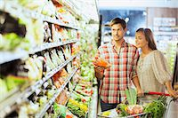 Couple shopping together in grocery store Stock Photo - Premium Royalty-Freenull, Code: 6113-07790961