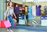 people on mall - Woman carrying shopping bags in shopping mall Stock Photo - Premium Royalty-Freenull, Code: 6113-07791020
