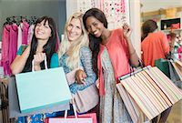 Women shopping together in clothing store Stock Photo - Premium Royalty-Freenull, Code: 6113-07791095
