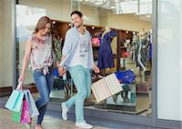 people on mall - Couple carrying shopping bags in shopping mall Stock Photo - Premium Royalty-Freenull, Code: 6113-07791113